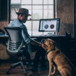 TAKE FIVE Designer with their dog