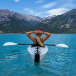 TAKE FIVE Person in Kayak on Water